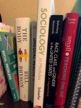 research / Pulmonary Fibrosis News / Photo of sociology instructor textbooks